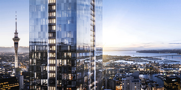 Shiny new Pacifica building with Auckland skyline behind